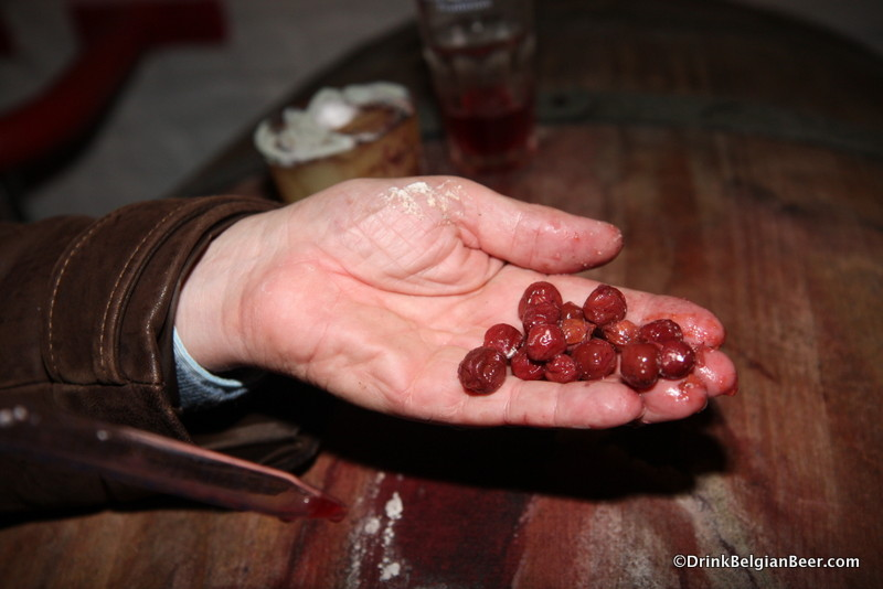 Photo of whole cherries from a barrel.