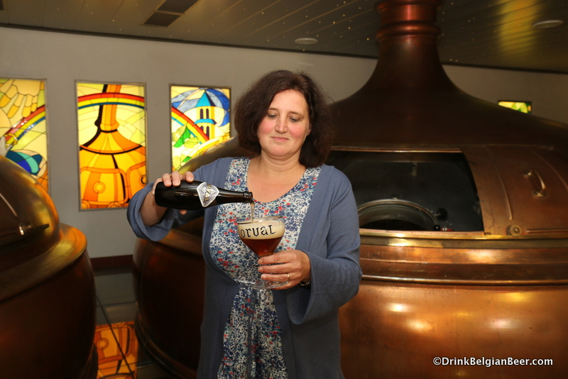 Anne-Françoise Pypaert, brewmaster, Brasserie d' Orval, pouring an Orval in the breewhouse.
