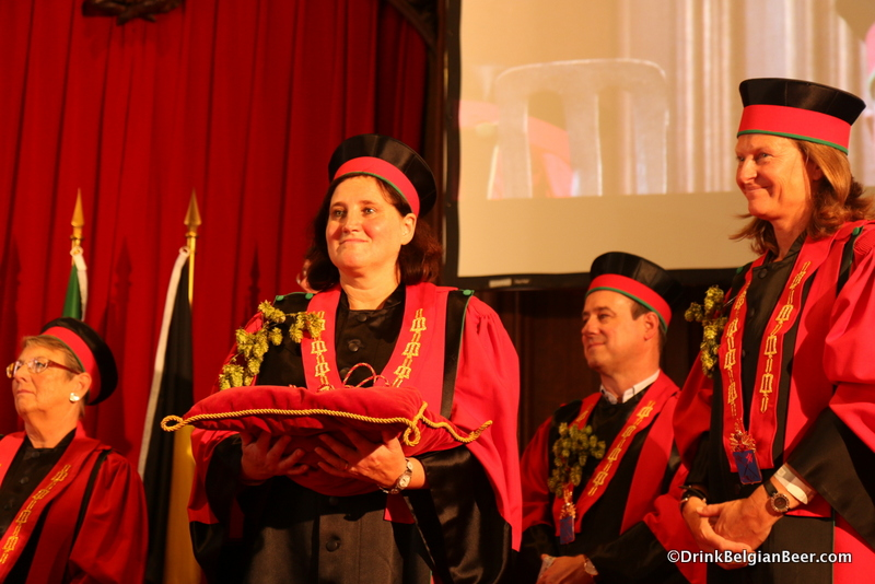 Anne-Françoise Pypaert, preparing to give a symbol of the office to a new member of the Knighthood of the Brewer's Mash Staff inside the Brussels Town Hall.