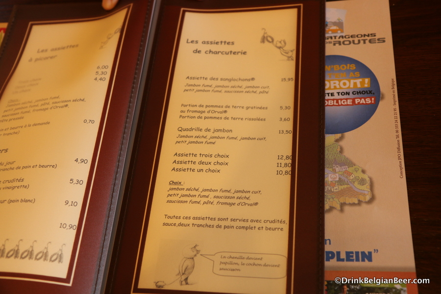 One of the menu pages at La Ferme de Sanglochons, with the signature house dishes.