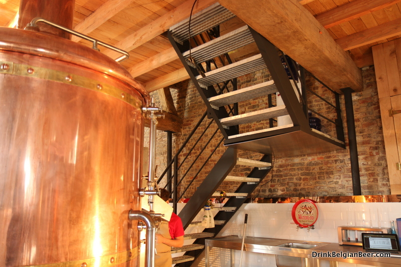 The brewery mash tun is on the left. Steps lead to a second floor, where grains and other supplies are kept.