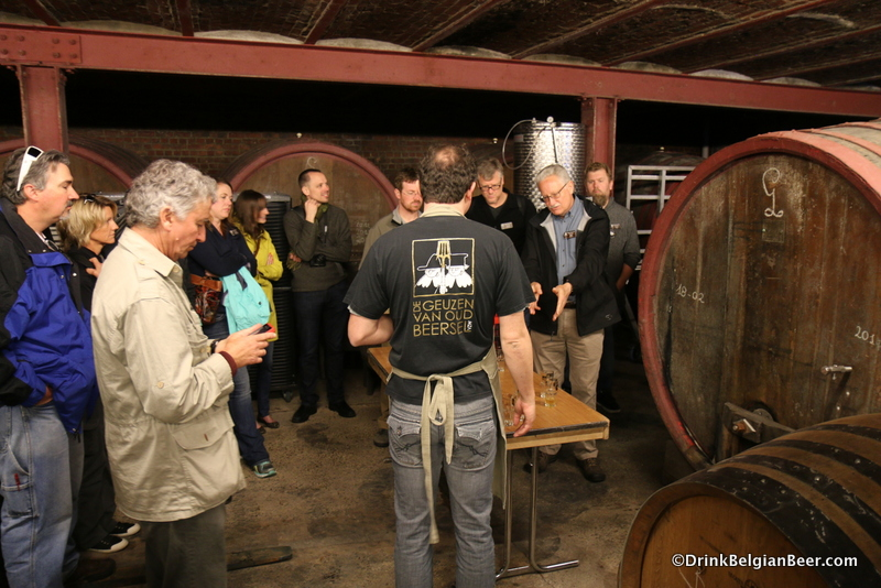 The group in a room full of 40+ hl foeders at Oud Beersel.