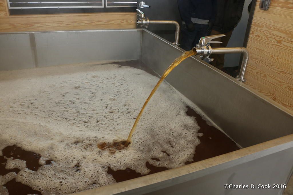 Another angle of The Veil's coolship filling with wort.