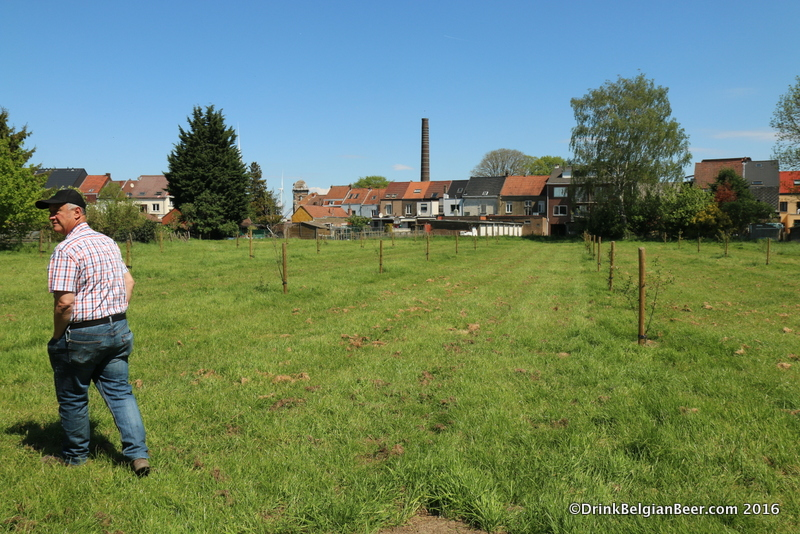 Armand Debelder walks in the future orchard behind the new site.