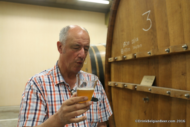 Armand sampling a six month old lambic, pulled directly from a foeder.