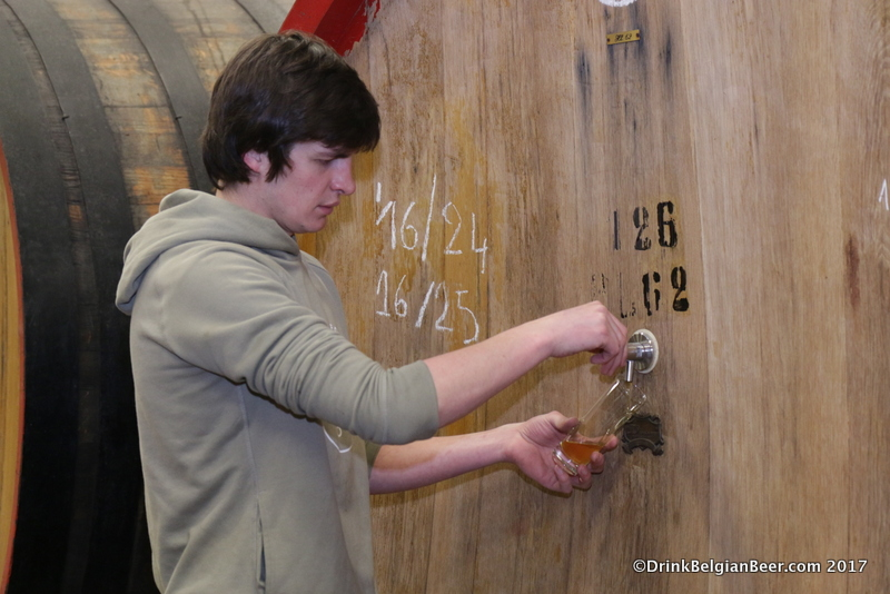 Michaël Blancquaert pulling a lambic from a barrel at 3 Fonteinen.