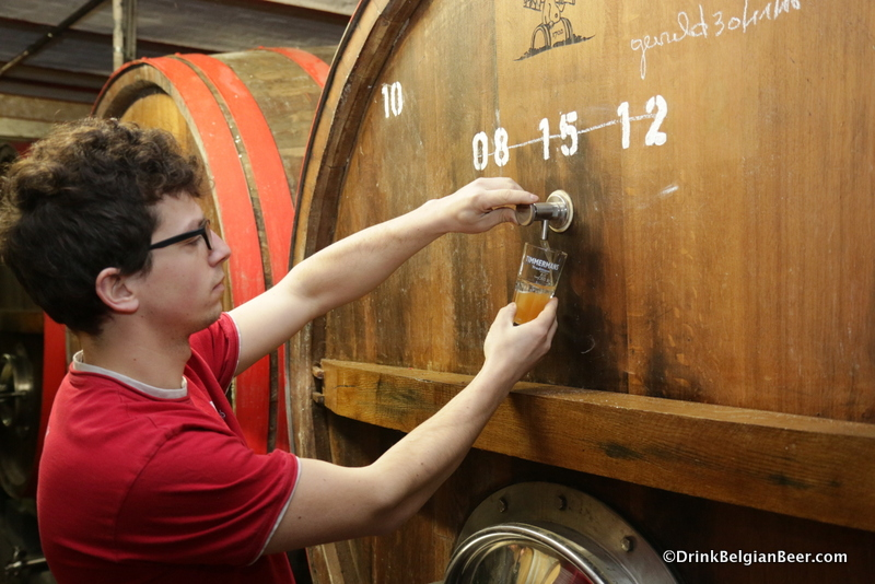Brewer Kloris Deville pulling a glass of lambic from another foeder. This was a really good day of tasting at Timmermans!