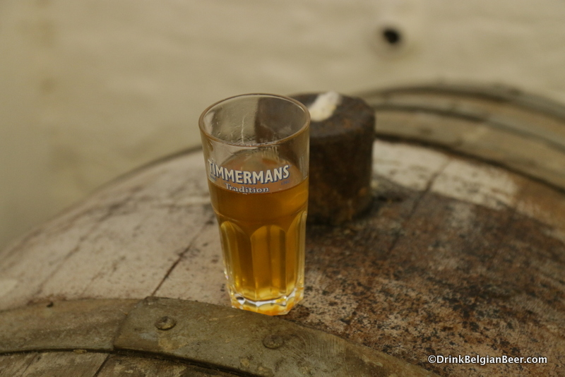Glass of lambic on a barrel, Timmermans.