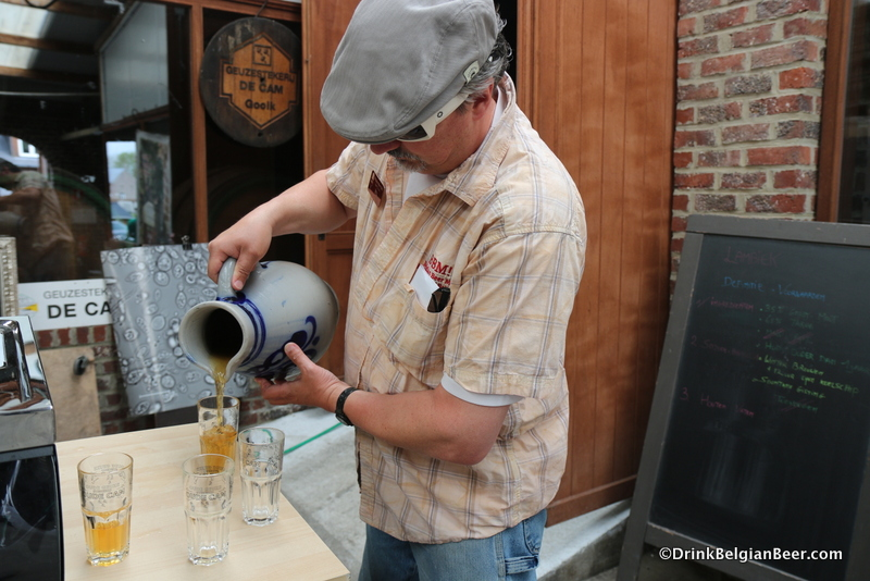 Stu Stuart of Belgian Beer Me! Tours pouring straight draft lambic from a jug at at De Cam.