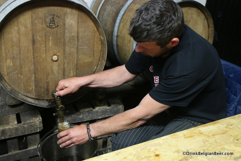 Pulling lambic from a barrel at Hanssens.
