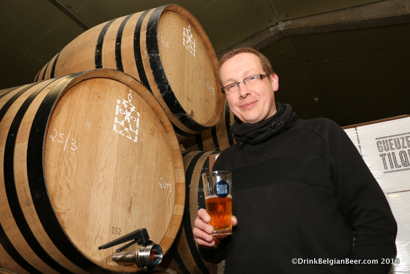 Pierre Tilquin with a glass of lambic pulled directly from the 400-liter barrel to his right.