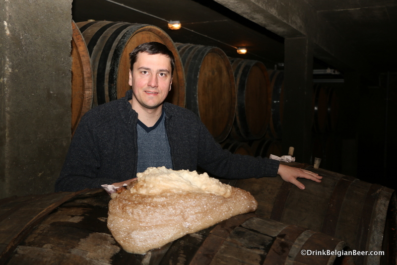Gert Christiaens at a barrel with active fermentation.