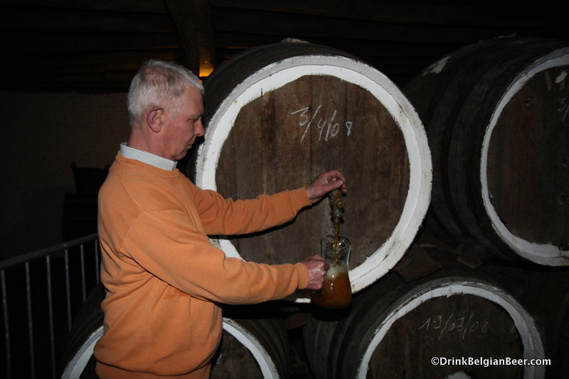 Pulling a lambic from a barrel at De Troch.