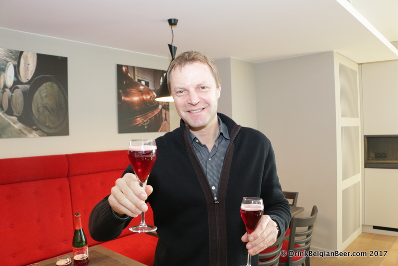 Dirk Lindemans with glasses of Oude Kriek.