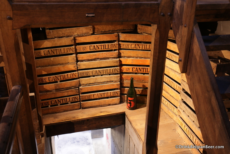 Old wooden crates under the steps leading into the Brasserie Cantillon coolship room.