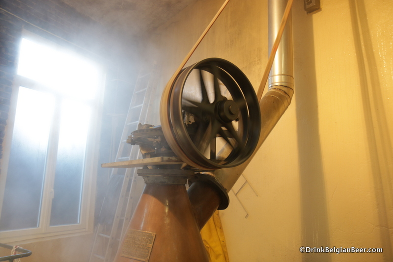 Another view of the belt and pulley on top of the left boiling kettle, in action.