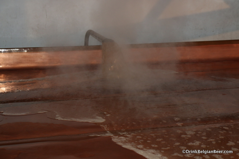 Wort flows into the coolship at Brasserie Cantillon.