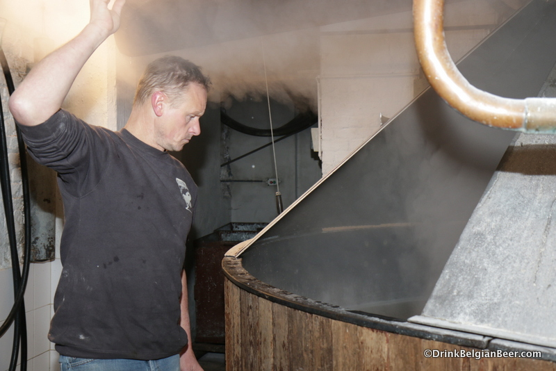 Jean Van Roy, keeping a close eye on the progress in the mash tun.