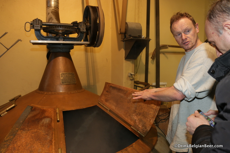 Jean Van Roy at the left boiling kettle. You can see a stream of wort being pumped into the kettle.