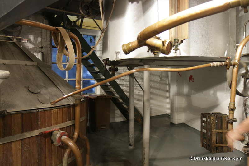View of the mash tun and the underside of the left boiling kettle. The stairs in the background lead to the second floor, where the brewhouse is located.