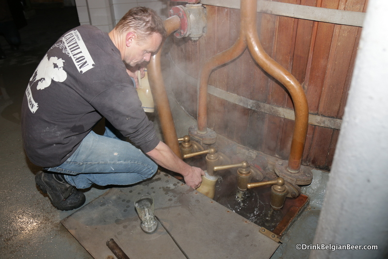 JVR filling a pitcher with warm wort.