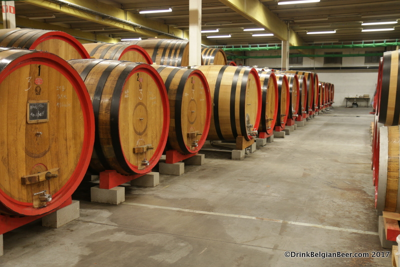 "A row of smaller foeders (10 to 20 hectoliters.) The number ""3"" on the barrel indicates it is filled with lambic brewed at 3 Fonteinen."