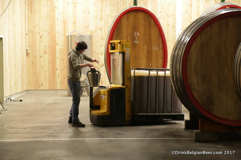 Michael Blancquaert moving a container of wort at de lambik-o-droom.