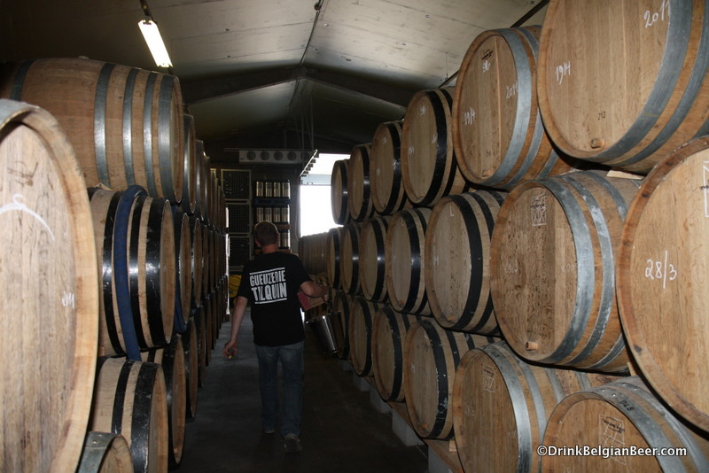 Rows of 400-liter barrels at Gueuzerie Tilquin.