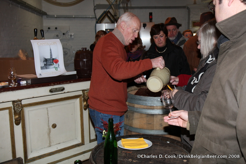 Jean-Pierre Van Roy pouring Cantillon lambic from a pitcher during Quintessence in 2008. Note the Grand Cru Bruoscella sign behind him.