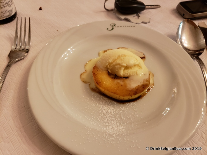 A dessert of a local apple topped with vanilla ice cream and with barrel aged soy sauce from Japan. A sumptuous treat!