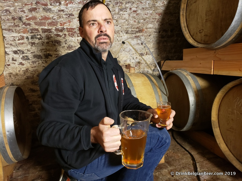 Brouwerij Sako brewer Koen Christiaens with a pitcher of lambic pulled directly from a barrel in his circa 1800 cellar.