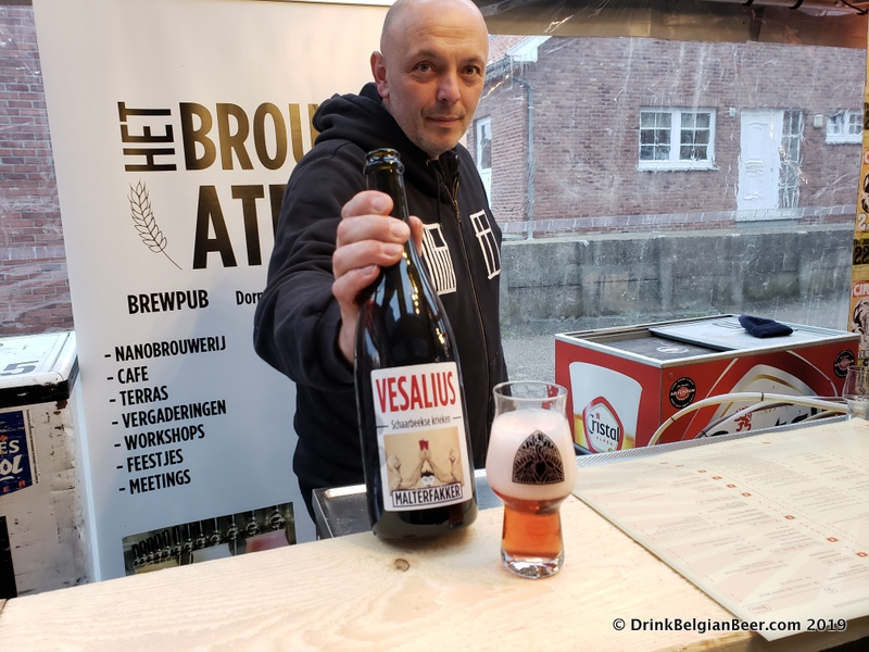 Steven Bollion of Malterfakker and Het Brouwateljee in Lubeek, a cafe where you can drink and eat, with a brewery. He holds Vesalius, a delicious fruit beer made with Schaarbeekse Krieken.