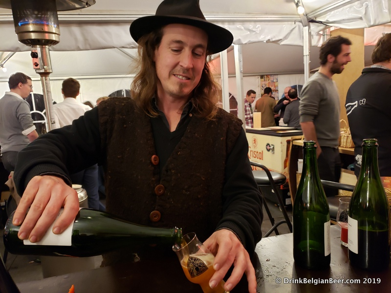 "Tom Jacobs of Antidoot-Wilde Fermenten pouring a ""Nacht van de Geit"" at Gebrande Winning. This beer is described as an ""International Gruit Ale"" and was a collab with several other breweries."